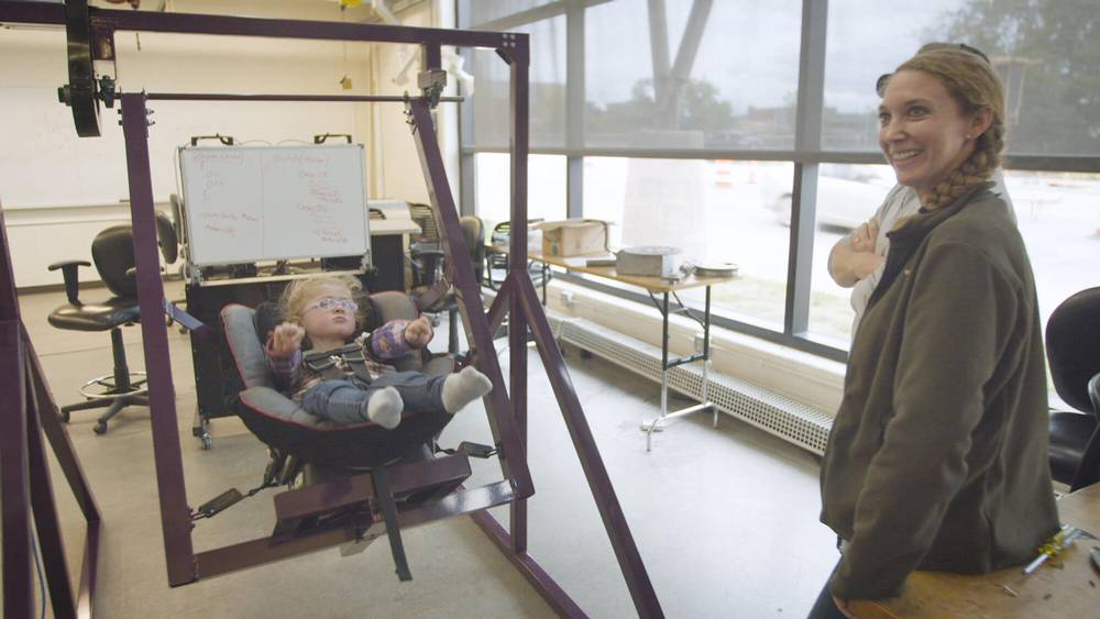 Grand Valley student engineers build custom swing for child with special needs